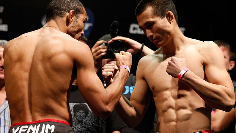 "RIO DE JANEIRO, BRAZIL - AUGUST 02:  (L-R) Opponents Jose Aldo and ""The Korean Zombie"" Chan Sung Jung face off during the UFC 163 weigh-in at HSBC Arena on August 2, 2013 in Rio de Janeiro, Brazil. (Photo by Josh Hedges/Zuffa LLC/Zuffa LLC via Getty Image"