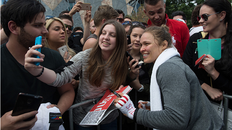 MELBOURNE, AUSTRALIA - NOVEMBER 12:  UFC women's bantamweight champion Ronda Rousey of the United States takes pictures with fans at Federation Square on November 12, 2015 in Melbourne, Australia. (Photo by Brandon Magnus/Zuffa LLC/Zuffa LLC via Getty Ima