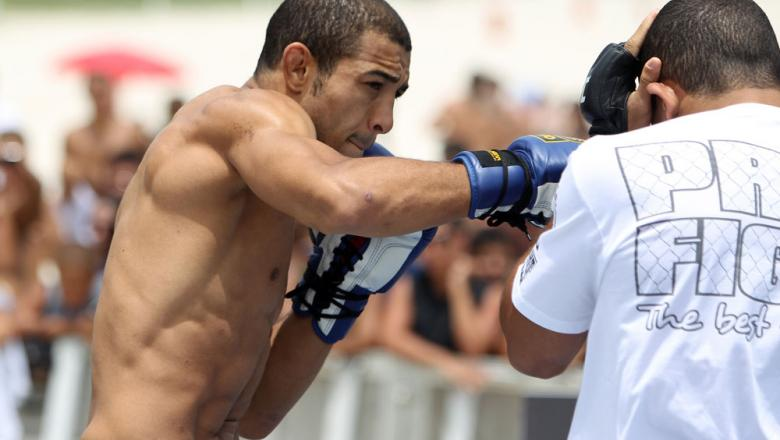 RIO DE JANEIRO, BRAZIL - JANUARY 11:  Jose Aldo works out for the media and fans during the UFC 142 Open Workouts at Barra de Tijuca Beach on January 11, 2012 in Rio de Janeiro, Brazil.  (Photo by Josh Hedges/Zuffa LLC/Zuffa LLC via Getty Images)