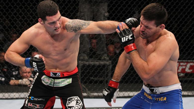 CHICAGO, IL - JANUARY 28:  (L-R) Chris Weidman punches Demian Maia during the UFC on FOX event at United Center on January 28, 2012 in Chicago, Illinois.  (Photo by Nick Laham/Zuffa LLC/Zuffa LLC via Getty Images) *** Local Caption *** Chris Weidman; Demi