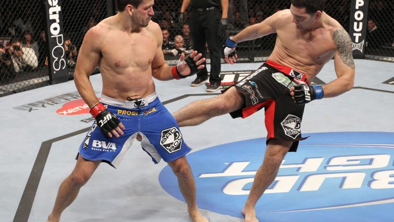 CHICAGO, IL - JANUARY 28:  (R-L) Chris Weidman kicks Demian Maia during the UFC on FOX event at United Center on January 28, 2012 in Chicago, Illinois.  (Photo by Nick Laham/Zuffa LLC/Zuffa LLC via Getty Images) *** Local Caption *** Chris Weidman; Demian