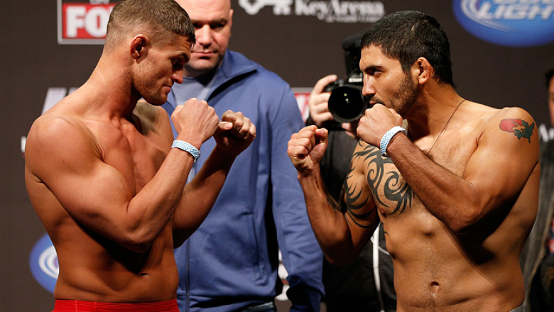 SEATTLE, WA - DECEMBER 07:  (L-R) Opponents Daron Cruickshank and Henry Martinez face off during the official UFC on FOX weigh in on December 7, 2012 at Key Arena in Seattle, Washington.  (Photo by Josh Hedges/Zuffa LLC/Zuffa LLC via Getty Images)