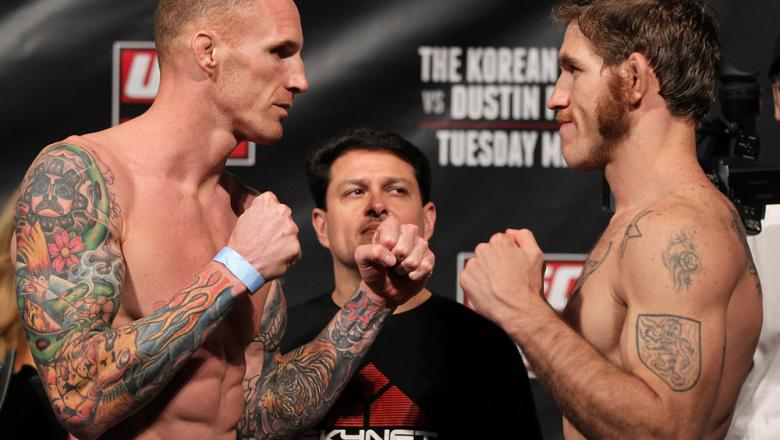 FAIRFAX, VA - MAY 14:  (L-R) Middleweight opponents Jason MacDonald and Tom Lawlor face off after weighing in during the UFC on Fuel TV official weigh in at Patriot Center on May 14, 2012 in Fairfax, Virginia.  (Photo by Josh Hedges/Zuffa LLC/Zuffa LLC vi
