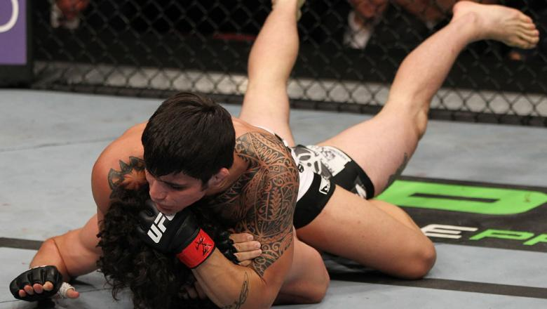 SUNRISE, FL - JUNE 08:   (R-L) Erick Silva defeats Charlie Brenneman with a rear choke submission in a Welterweight bout during the UFC on FX 3 event at Bank Atlantic Center on June 8, 2012 in Sunrise, Florida.  (Photo by Josh Hedges/Zuffa LLC/Zuffa LLC v