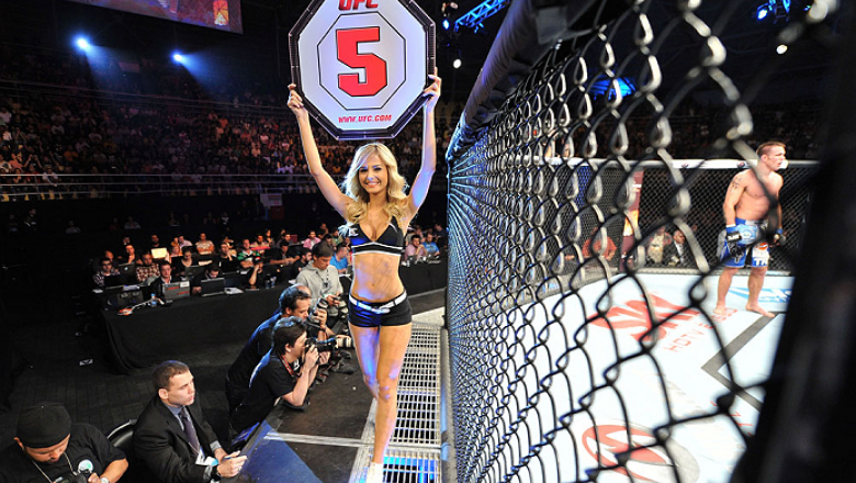 BARUERI, BRAZIL - OCTOBER 9:  UFC Octagon Girl Jhenny Andrade walks the Octagon before round five for the welterweight bout between Jake Shields and Demian Maia during the UFC Fight Night event at the Ginasio Jose Correa on October 9, 2013 in Barueri, Sao