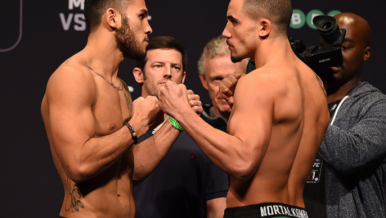 ADELAIDE, AUSTRALIA - MAY 09:   (L-R) Opponents Brad Tavares of the United States and Robert Whittaker of New Zealand face off during the UFC weigh-in event at the Adelaide Entertainment Centre on May 9, 2015 in Adelaide, Australia. (Photo by Josh Hedges/