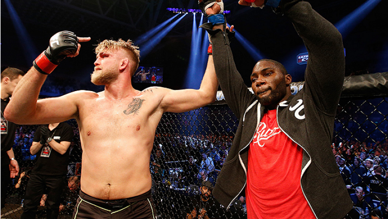 STOCKHOLM, SWEDEN - JANUARY 24:  (L-R) Alexander Gustafsson of Sweden raises opponent Anthony Johnson's hand after Johnson knocked out Gustafsson in their light heavyweight bout during the UFC Fight Night event at the Tele2 Arena on January 24, 2015 in St