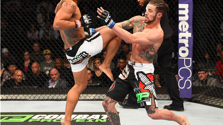 BROOMFIELD, CO - FEBRUARY 14:  (L-R) Benson Henderson attempts a flying knee against Brandon Thatch in their welterweight fight during the UFC Fight Night event inside 1stBank Center on February 14, 2015 in Broomfield, Colorado. (Photo by Josh Hedges/Zuff
