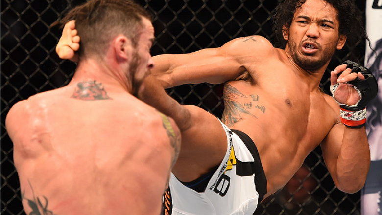 BROOMFIELD, CO - FEBRUARY 14:  (R-L) Benson Henderson lands a kick to the head of Brandon Thatch in their welterweight fight during the UFC Fight Night event inside 1stBank Center on February 14, 2015 in Broomfield, Colorado. (Photo by Josh Hedges/Zuffa L