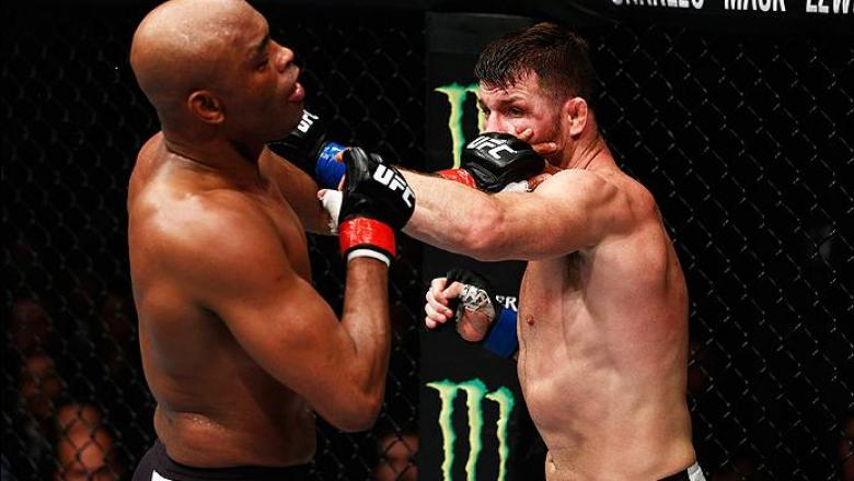 LONDON, ENGLAND - FEBRUARY 27:  Anderson 'The Spider' Silva of Brazil (L) and Michael 'The Count' Bisping of England (R) compete in their Middleweight bout during the UFC Fight Night held at at Indigo at The O2 Arena on February 27, 2016 in London, Englan