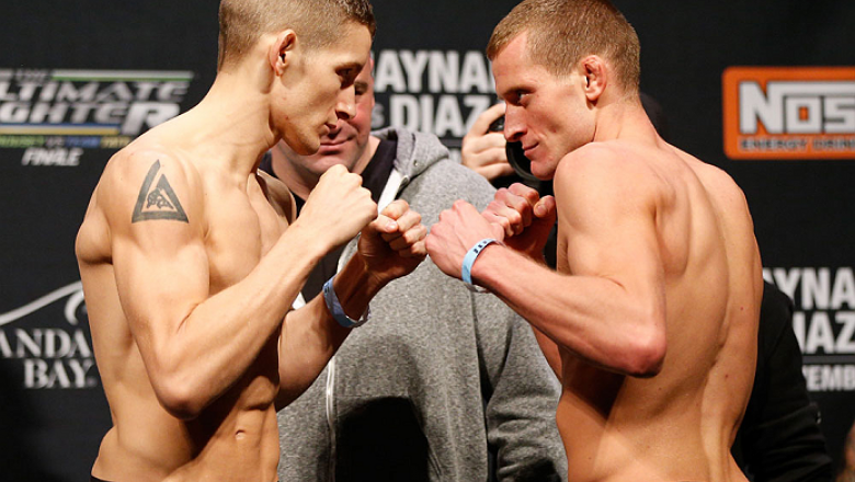 "LAS VEGAS, NV - NOVEMBER 29:  (L-R) Opponents Chris Holdsworth and David ""Davey"" Grant face off during the weigh-in for The Ultimate Fighter season 18 live finale inside the Mandalay Bay Events Center on November 29, 2013 in Las Vegas, Nevada. (Photo by J"