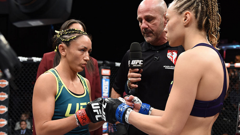 LAS VEGAS, NEVADA - DECEMBER 12: (R-L) Rose Namajunas and Carla Esparza face-off in their strawweight championship fight during The Ultimate Fighter Finale event inside the Pearl concert theater at the Palms Casino Resort on December 12, 2014 in Las Vegas