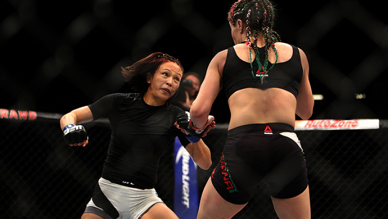 LAS VEGAS, NV - JULY 12:  (L-R) Michelle Waterson punches Angela Magana in their women's strawweight bout during the Ultimate Fighter Finale inside MGM Grand Garden Arena on July 12, 2015 in Las Vegas, Nevada.  (Photo by Mitch Viquez/Zuffa LLC/Zuffa LLC v
