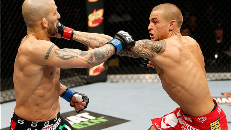 QUEBEC CITY, CANADA - APRIL 16:  (R-L) Dustin Poirier punches Akira Corassani in their featherweight fight during the TUF Nations Finale at Colisee Pepsi on April 16, 2014 in Quebec City, Quebec, Canada. (Photo by Josh Hedges/Zuffa LLC/Zuffa LLC via Getty