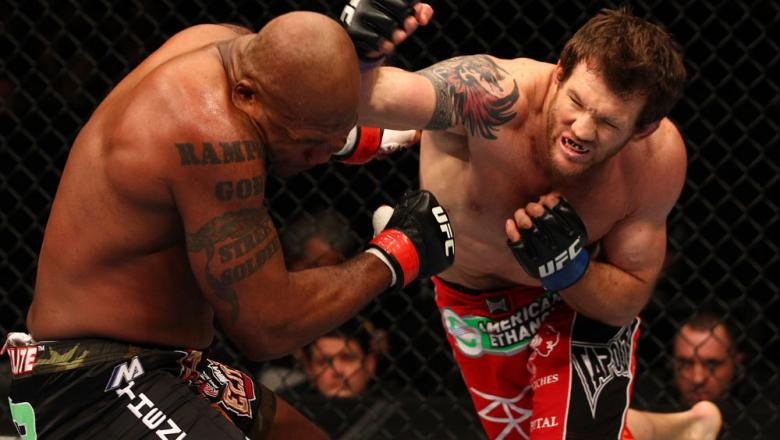 "SAITAMA, JAPAN - FEBRUARY 26:  (R-L) Ryan Bader punches Quinton ""Rampage"" Jackson during the UFC 144 event at Saitama Super Arena on February 26, 2012 in Saitama, Japan.  (Photo by Al Bello/Zuffa LLC/Zuffa LLC via Getty Images) *** Local Caption *** Quint"