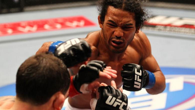 SAITAMA, JAPAN - FEBRUARY 26:  (R-L) Benson Henderson punches Frankie Edgar during the UFC 144 event at Saitama Super Arena on February 26, 2012 in Saitama, Japan.  (Photo by Al Bello/Zuffa LLC/Zuffa LLC via Getty Images) *** Local Caption *** Frankie Edg