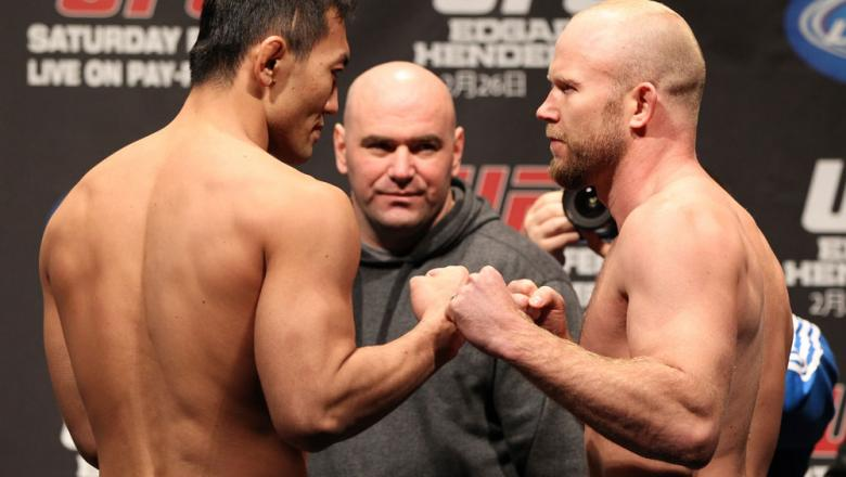 SAITAMA, JAPAN - FEBRUARY 25:  (L-R) Middleweight opponents Yushin Okami and Tim Boetsch face off after weighing in during the official UFC 144 weigh in at the Saitama Super Arena on February 25, 2012 in Saitama, Japan.  (Photo by Josh Hedges/Zuffa LLC/Zu