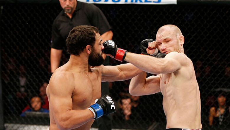 MONTREAL, QC - NOVEMBER 17:  Johny Hendricks (L) knocks out Martin Kampmann with a left in the first round to win their welterweight bout during UFC 154 on November 17, 2012  at the Bell Centre in Montreal, Canada.  (Photo by Josh Hedges/Zuffa LLC/Zuffa L