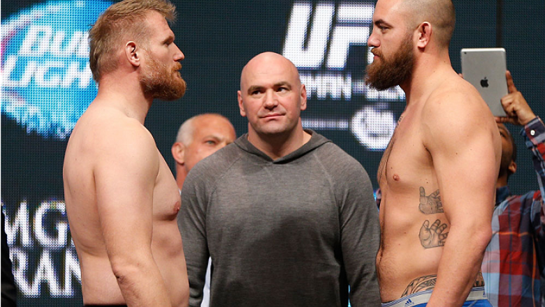 LAS VEGAS, NV - DECEMBER 27:  (L-R) Opponents Josh Barnett and Travis Browne face off during the UFC 168 weigh-in at the MGM Grand Garden Arena on December 27, 2013 in Las Vegas, Nevada. (Photo by Josh Hedges/Zuffa LLC/Zuffa LLC via Getty Images)