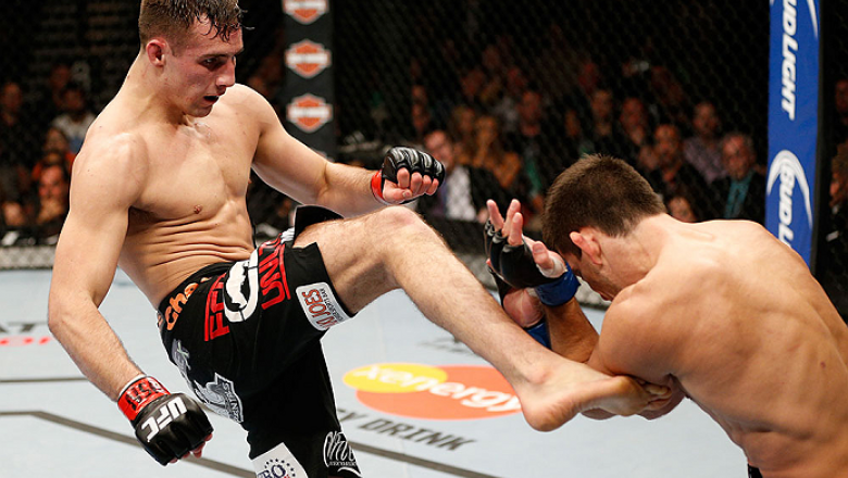 LAS VEGAS, NV - FEBRUARY 22:  (L-R) Rory MacDonald kicks Demian Maia in their welterweight bout during UFC 170 inside the Mandalay Bay Events Center on February 22, 2014 in Las Vegas, Nevada. (Photo by Josh Hedges/Zuffa LLC/Zuffa LLC via Getty Images) ***