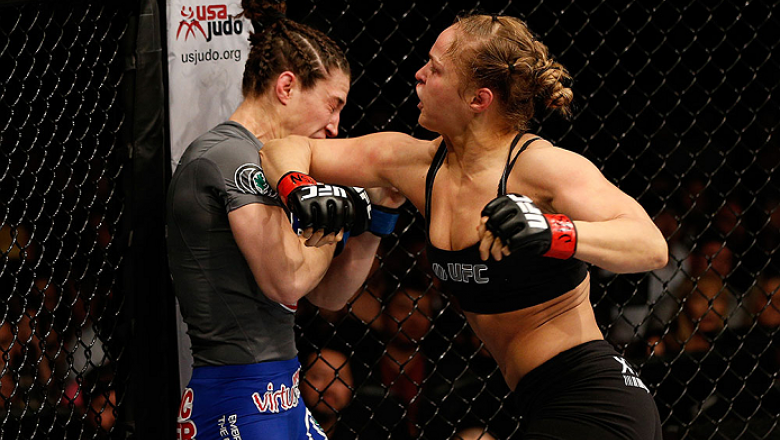 LAS VEGAS, NV - FEBRUARY 22:  Ronda Rousey (right) elbows Sara McMann in their women's bantamweight championship bout during UFC 170 inside the Mandalay Bay Events Center on February 22, 2014 in Las Vegas, Nevada. (Photo by Josh Hedges/Zuffa LLC/Zuffa LLC
