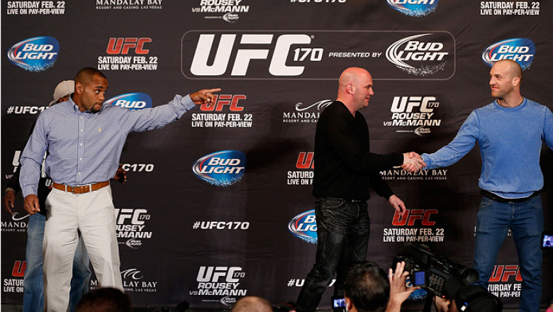 LAS VEGAS, NV - FEBRUARY 20:  Opponents Daniel Cormier (L) and Patrick Cummins (R) are separated by UFC President Dana White after a heated exchange during the final UFC 170 pre-fight press conference at the Mandalay Bay Resort and Casino on February 20,