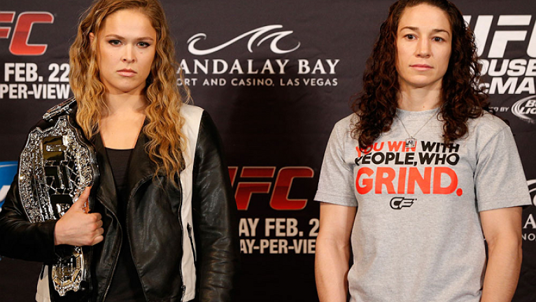 LAS VEGAS, NV - FEBRUARY 20:  (L-R) Opponents Ronda Rousey and Sara McMann pose for photos during the final UFC 170 pre-fight press conference at the Mandalay Bay Resort and Casino on February 20, 2014 in Las Vegas, Nevada. (Photo by Josh Hedges/Zuffa LLC