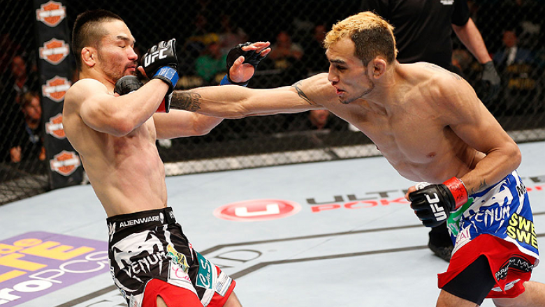 LAS VEGAS, NV - MAY 24:  (R-L) Tony Ferguson punches Katsunori Kikuno in their lightweight bout during the UFC 173 event at the MGM Grand Garden Arena on May 24, 2014 in Las Vegas, Nevada. (Photo by Josh Hedges/Zuffa LLC/Zuffa LLC via Getty Images)
