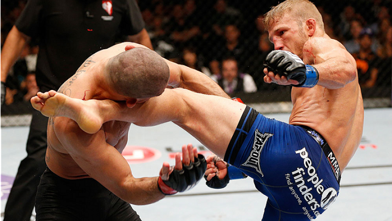 LAS VEGAS, NV - MAY 24:  (R-L) T.J. Dillashaw kicks Renan Barao in their bantamweight championship bout during the UFC 173 event at the MGM Grand Garden Arena on May 24, 2014 in Las Vegas, Nevada. (Photo by Josh Hedges/Zuffa LLC/Zuffa LLC via Getty Images