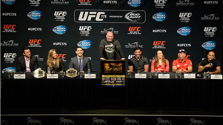 LAS VEGAS, NV - MAY 23:  (L-R) Chael Sonnen, UFC Women's Bantamweight Champion Ronda Rousey, UFC Middleweight Champion Chris Weidman, UFC President Dana White, Lyoto Machida, Alexis Davis, Wanderlei Silva and BJ Penn speak to the media during the UFC 175