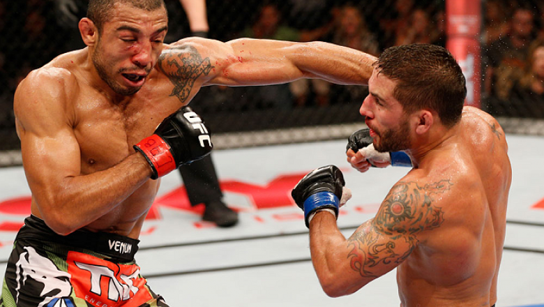 RIO DE JANEIRO, BRAZIL - OCTOBER 25:  (L-R) Jose Aldo of Brazil punches Chad Mendes in their featherweight championship bout during the UFC 179 event at Maracanazinho on October 25, 2014 in Rio de Janeiro, Brazil.  (Photo by Josh Hedges/Zuffa LLC/Zuffa LL
