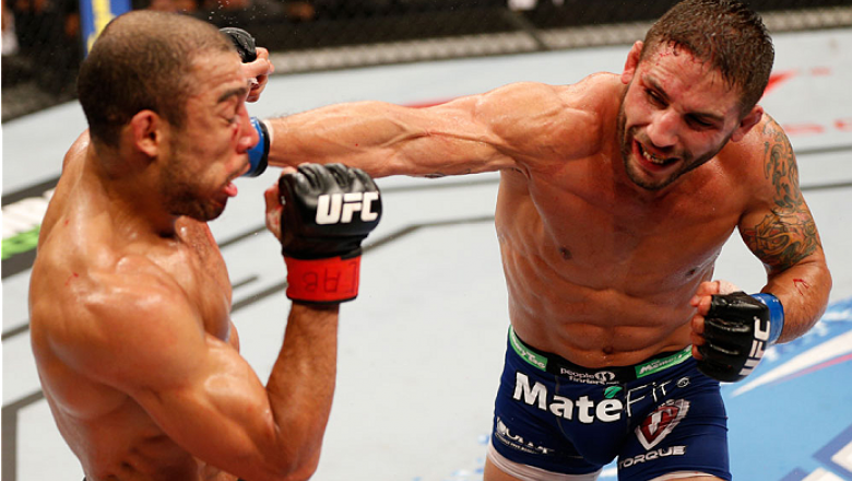 RIO DE JANEIRO, BRAZIL - OCTOBER 25:  (R-L) Chad Mendes punches Jose Aldo of Brazil in their featherweight championship bout during the UFC 179 event at Maracanazinho on October 25, 2014 in Rio de Janeiro, Brazil.  (Photo by Josh Hedges/Zuffa LLC/Zuffa LL