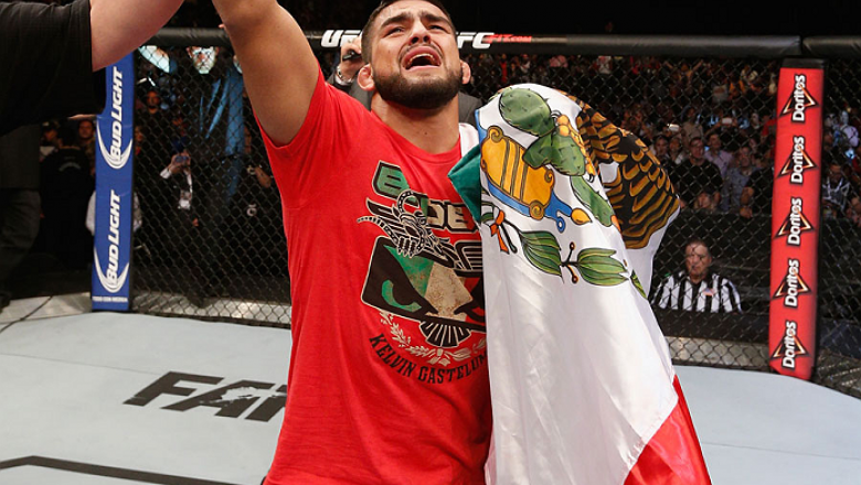 MEXICO CITY, MEXICO - NOVEMBER 15:  Kelvin Gastelum celebrates his submission victory over Jake Ellenberger in their welterweight bout during the UFC 180 event at Arena Ciudad de Mexico on November 15, 2014 in Mexico City, Mexico.  (Photo by Josh Hedges/Z