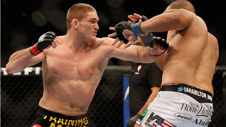 LAS VEGAS, NV - DECEMBER 06:  (L-R) Todd Duffee punches Anthony Hamilton in their heavyweight bout during the UFC 181 event inside the Mandalay Bay Events Center on December 6, 2014 in Las Vegas, Nevada.  (Photo by Josh Hedges/Zuffa LLC/Zuffa LLC via Gett