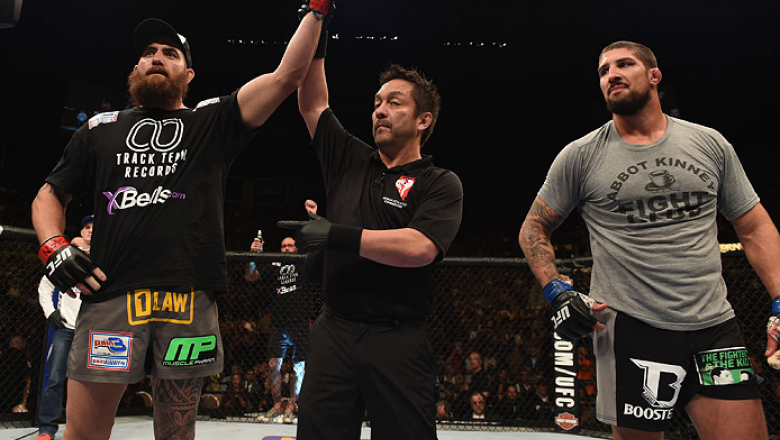 LAS VEGAS, NV - DECEMBER 06:  Travis Browne (left) is declared the winner over Brendan Schaub (right) in their heavyweight bout during the UFC 181 event inside the Mandalay Bay Events Center on December 6, 2014 in Las Vegas, Nevada.  (Photo by Robert Labe