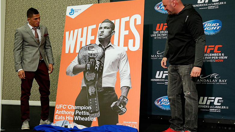 LAS VEGAS - DECEMBER 04:  (R-L) UFC president Dana White and lightweight champion Anthony Pettis reveal the new Wheaties box artwork featuring Pettis during the UFC 181 Ultimate Media Day at the MGM Grand Hotel/Casino on December 4, 2014 in Las Vegas, Nev