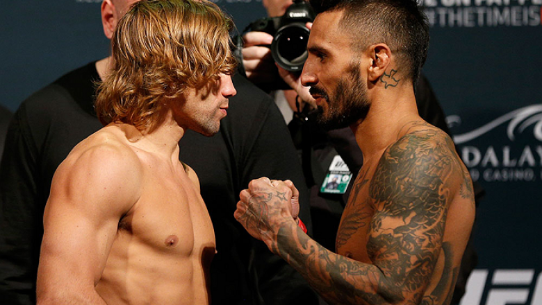 LAS VEGAS, NV - DECEMBER 05:  (L-R) Opponents Urijah Faber and Francisco Rivera face off during the UFC 181 weigh-in inside the Mandalay Bay Events Center on December 5, 2014 in Las Vegas, Nevada.  (Photo by Josh Hedges/Zuffa LLC/Zuffa LLC via Getty Image