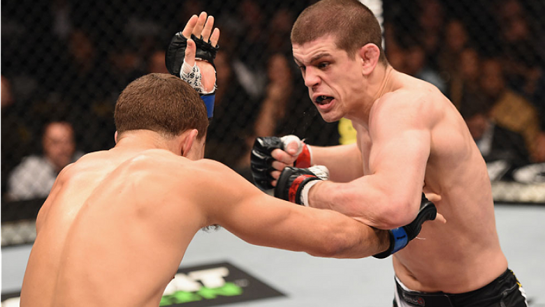 LAS VEGAS, NV - JANUARY 31:  (R-L) Joe Lauzon punches Al Iaquinta in their lightweight bout during the UFC 183 event at the MGM Grand Garden Arena on January 31, 2015 in Las Vegas, Nevada.  (Photo by Josh Hedges/Zuffa LLC/Zuffa LLC via Getty Images) *** L