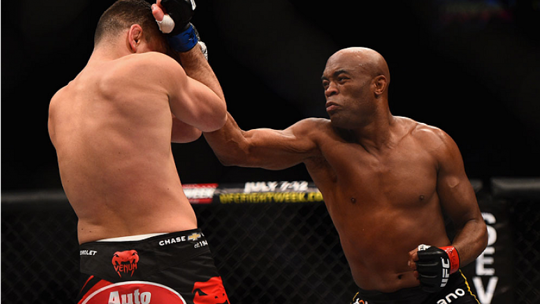 LAS VEGAS, NV - JANUARY 31:  (R-L)  Anderson Silva punches Nick Diaz in their middleweight bout during the UFC 183 event at the MGM Grand Garden Arena on January 31, 2015 in Las Vegas, Nevada.  (Photo by Jeff Bottari/Zuffa LLC/Zuffa LLC via Getty Images)