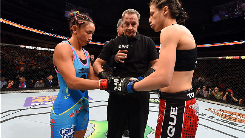DALLAS, TX - MARCH 14:  (L-R) UFC women's strawweight champion Carla Esparza and Joanna Jedrzejczyk touch gloves before their UFC women's strawweight championship bout during the UFC 185 event at the American Airlines Center on March 14, 2015 in Dallas, T