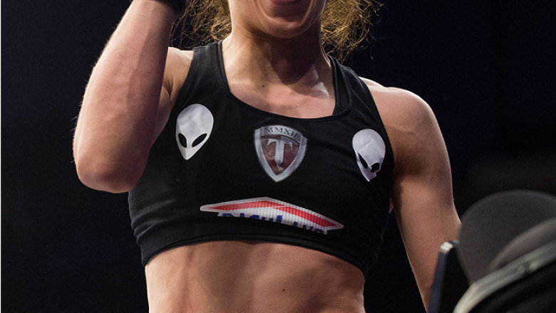 DALLAS, TX - MARCH 14:  Joanna Jedrzejczyk celebrates after defeating Carla Esparza and becoming the new UFC women's strawweight champion during UFC 185 at the American Airlines Center on March 14, 2015 in Dallas, Texas. (Photo by Cooper Neill/Zuffa LLC/Z