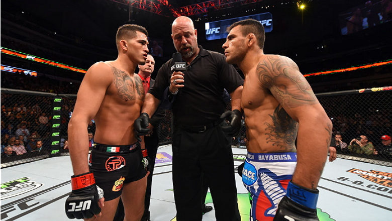 DALLAS, TX - MARCH 14:  (L-R) UFC Lightweight Champion Anthony Pettis and challenger Rafael dos Anjos of Brazil face off before their UFC lightweight championship bout during the UFC 185 event at the American Airlines Center on March 14, 2015 in Dallas, T