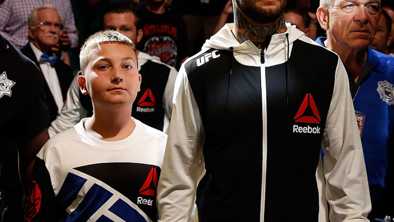 LAS VEGAS, NV - JULY 11:  Cody Garbrandt and a young fan walk to the Octagon during the UFC 189 event inside MGM Grand Garden Arena on July 11, 2015 in Las Vegas, Nevada.  (Photo by Christian Petersen/Zuffa LLC/Zuffa LLC via Getty Images) *** Local Captio