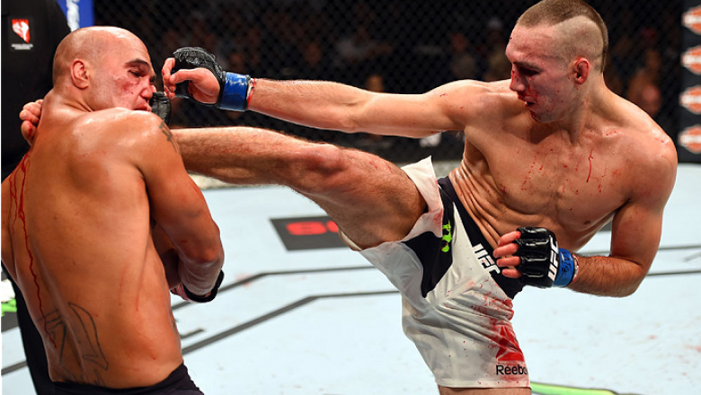LAS VEGAS, NV - JULY 11:  (R-L) Rory MacDonald kicks Robbie Lawler in their UFC welterweight title fight during the UFC 189 event inside MGM Grand Garden Arena on July 11, 2015 in Las Vegas, Nevada.  (Photo by Josh Hedges/Zuffa LLC/Zuffa LLC via Getty Ima