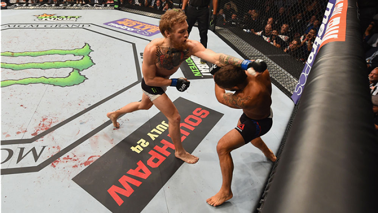 LAS VEGAS, NV - JULY 11:  (L-R) Conor McGregor punches Chad Mendes in their UFC interim featherweight title fight during the UFC 189 event inside MGM Grand Garden Arena on July 11, 2015 in Las Vegas, Nevada.  (Photo by Josh Hedges/Zuffa LLC/Zuffa LLC via