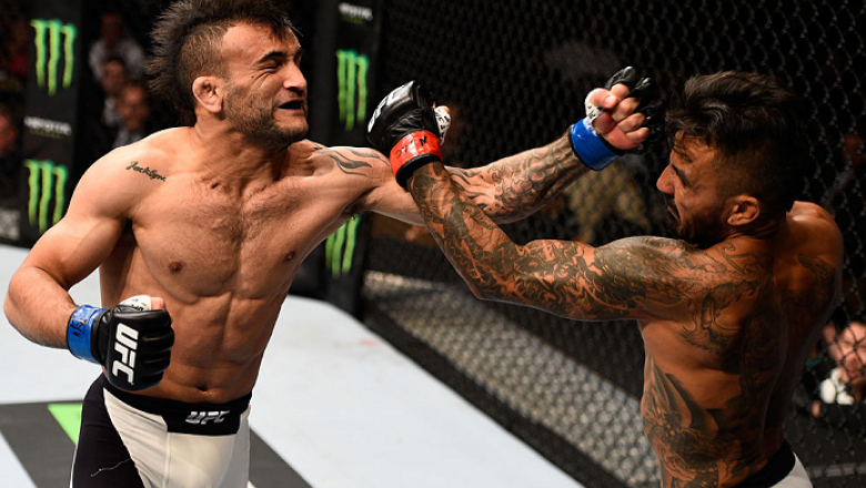 LAS VEGAS, NV - SEPTEMBER 05: (L-R) John Lineker and Francisco Rivera exchange punches in their bantamweight bout during the UFC 191 event inside MGM Grand Garden Arena on September 5, 2015 in Las Vegas, Nevada.  (Photo by Jeff Bottari/Zuffa LLC/Zuffa LLC