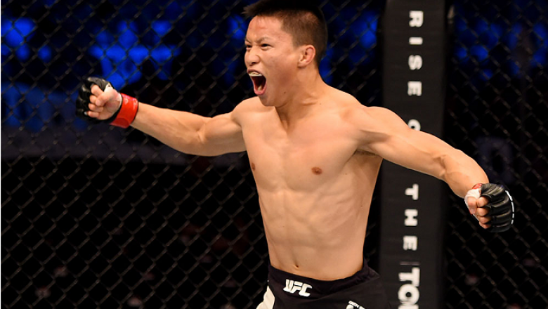 MELBOURNE, AUSTRALIA - NOVEMBER 15:  Ben Nguyen celebrates his win by submission due to rear naked choke against Ryan Benoit (not pictured) in their flyweight bout during the UFC 193 event at Etihad Stadium on November 15, 2015 in Melbourne, Australia.  (