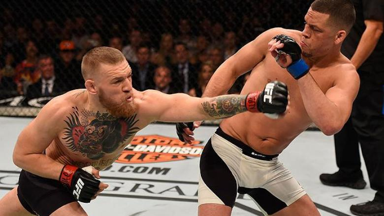 LAS VEGAS, NV - MARCH 05: (L-R) Conor McGregor of Ireland punches Nate Diaz in their welterweight bout during the UFC 196 event inside MGM Grand Garden Arena on March 5, 2016 in Las Vegas, Nevada.  (Photo by Josh Hedges/Zuffa LLC/Zuffa LLC via Getty Image