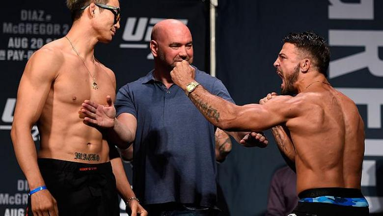 LAS VEGAS, NV - AUGUST 19:   (L-R) Opponents Hyun Gyu Lim of South Korea and Mike Perry face off during the UFC 202 weigh-in at the MGM Grand Hotel & Casino on August 19, 2016 in Las Vegas, Nevada. (Photo by Josh Hedges/Zuffa LLC/Zuffa LLC via Getty Image