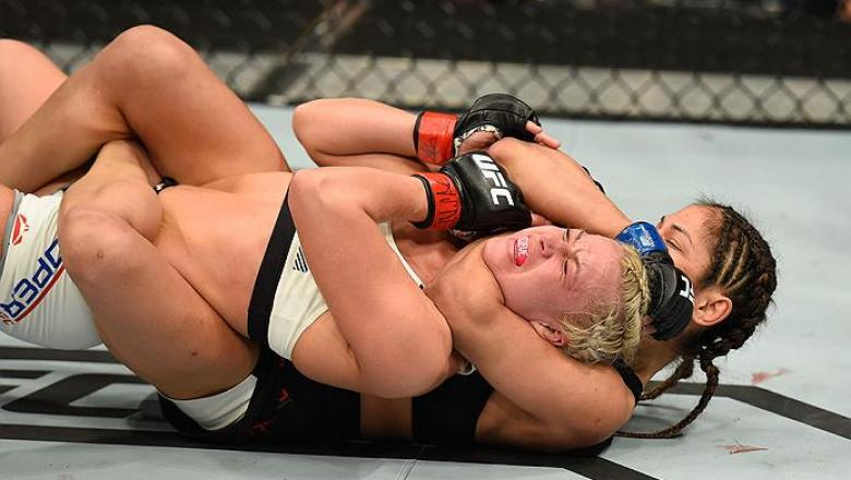 LAS VEGAS, NV - MARCH 04:  Cynthia Calvillo (black) attempts to submit Amanda Cooper in their women's strawweight bout during the UFC 209 event at T-Mobile Arena on March 4, 2017 in Las Vegas, Nevada.  (Photo by Josh Hedges/Zuffa LLC/Zuffa LLC via Getty I